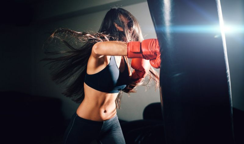 sexy fighter girl punching actively
