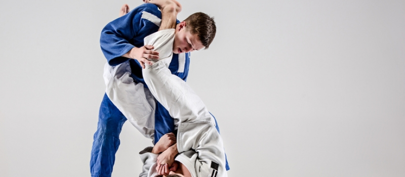 Two judokas fighters fighting men